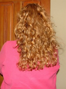 My long, curly hair in 2011 before I donated 10 inches to Locks of Love.