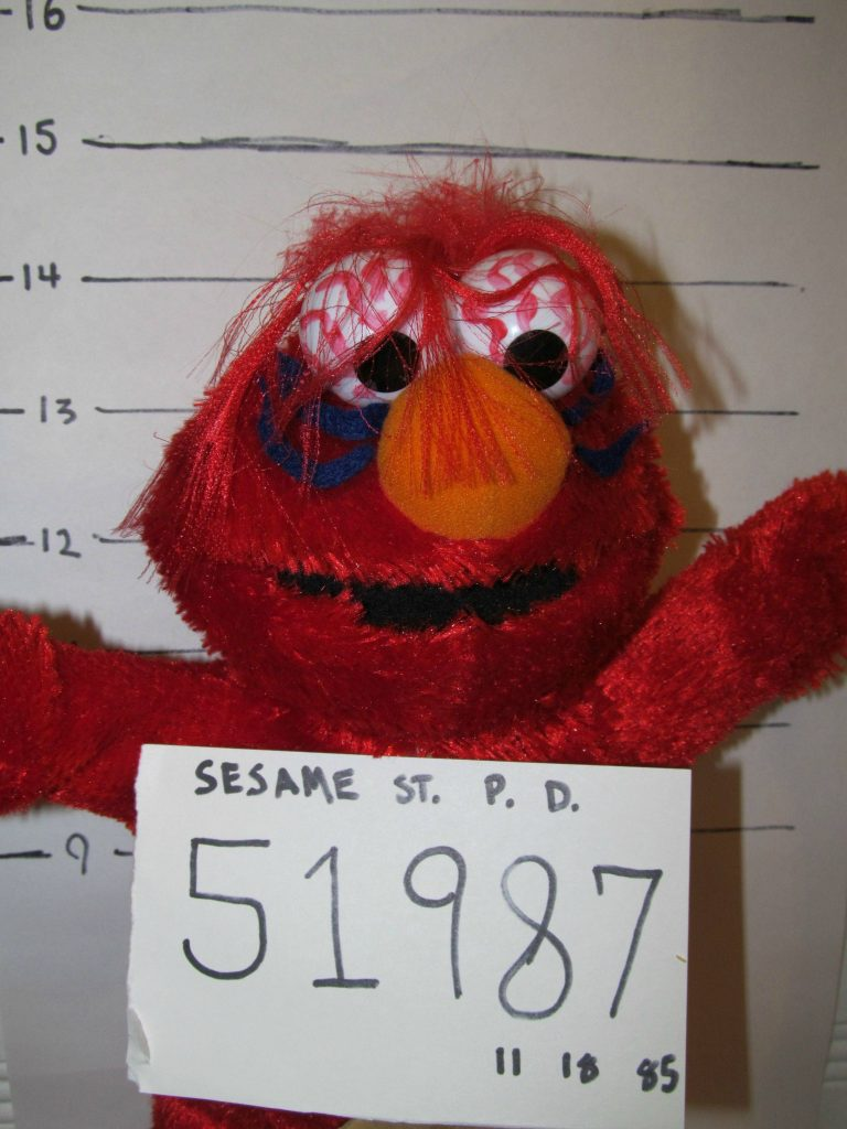 "G.I.S.H.W.H.E.S. I don't remember exactly what this one was looking for- something like ""A photo of Elmo after a bender"" Poor Elmo."